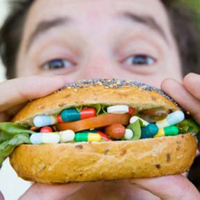 eating bun with pills